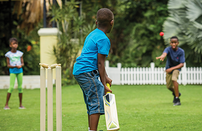 Kids Playing Cricket